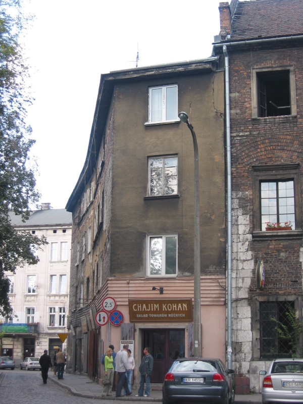 A building at Szeroka 1 with Long time ago in Kazimierz cafe, adilapidated tenement house