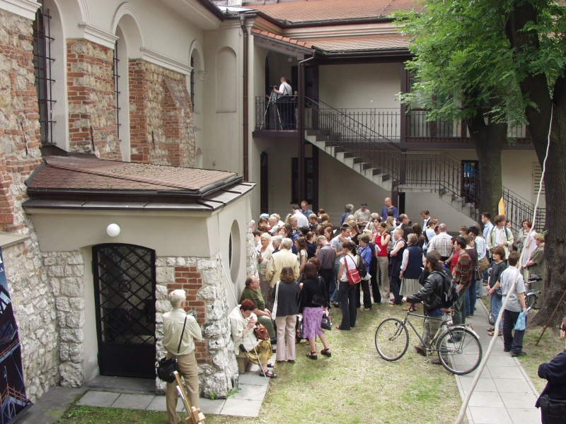 Courtyard of Kupa Synagogue, people waiting for an event to start