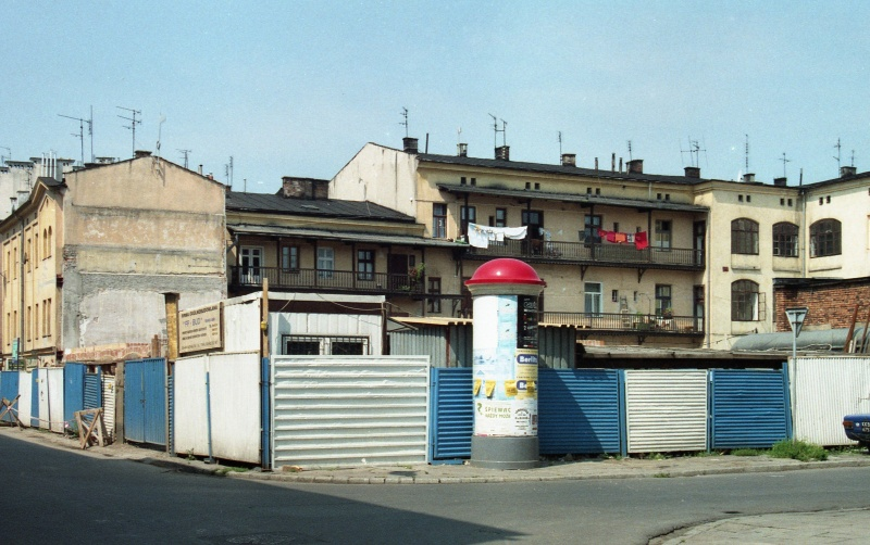 street junction, on the left Józefa street, on the right Estery street, okrąglak, square with corrugated iron fence, in the background outhouses