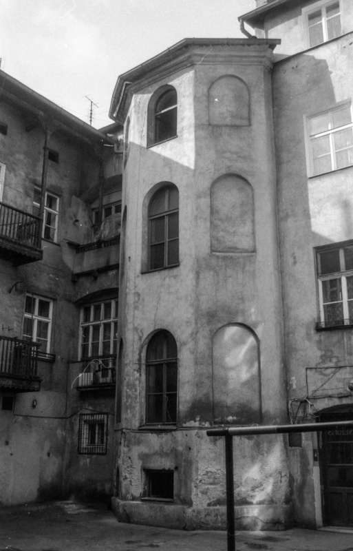 at the bottom courtyard, on the right carpet rack, fragment of internal tenement elevations, staircase protruding from the building wall
