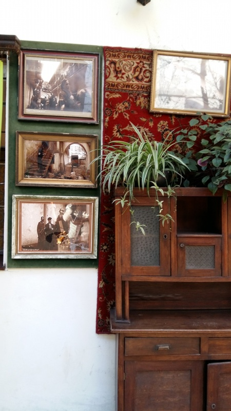 Historic photographs in a courtyard at 12 Józefa street