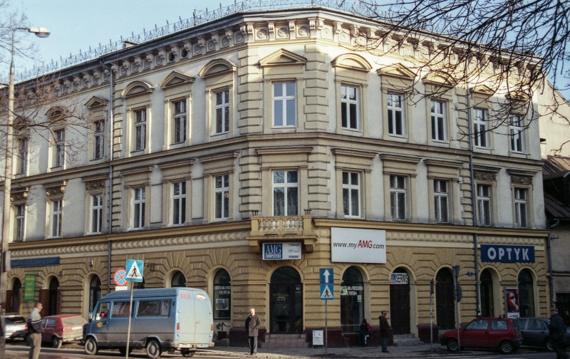 street, corner building, on the right exit of Bożego Ciała street, at the top branches
