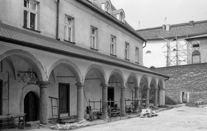 on the left cloisters, above first floor, on the right courtyard, inside wall with entrance opening (in the centre), at the top tenement floors (Józefa 11)
