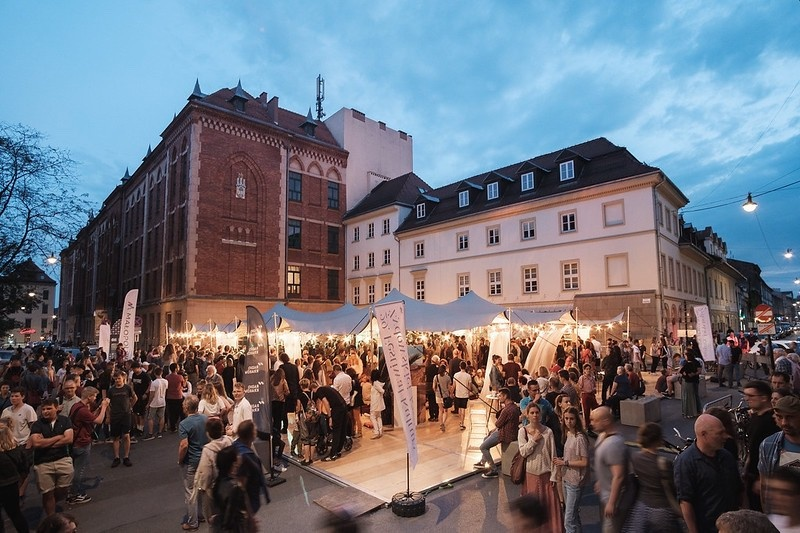Concert in a festival tent placed at a car park on the corner of Wąska and Józefa streets, in the background VI LO and buildings of the national health fund