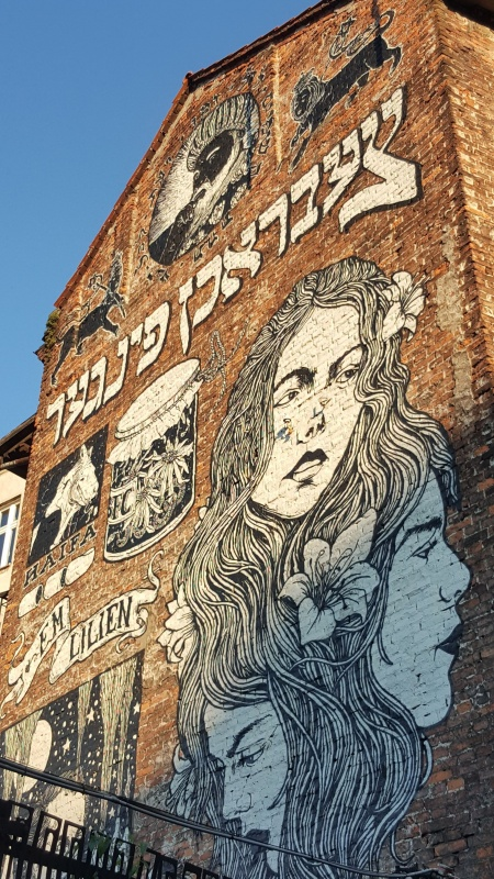 Mural inspired by works of Maurycy Lilien on the tenement house that belong to the Bosak family before the II World War, creted during the Jewish Culture Festival in 2014, authorship: Broken Fingaz