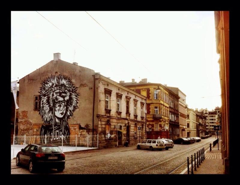 Judah mural on the wall of tenement at 14 Wawrzyńca street
