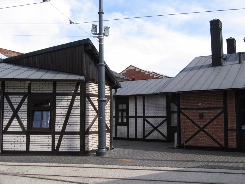renovated buildings I and E in the complex of the former tram depot, timber framed buildings