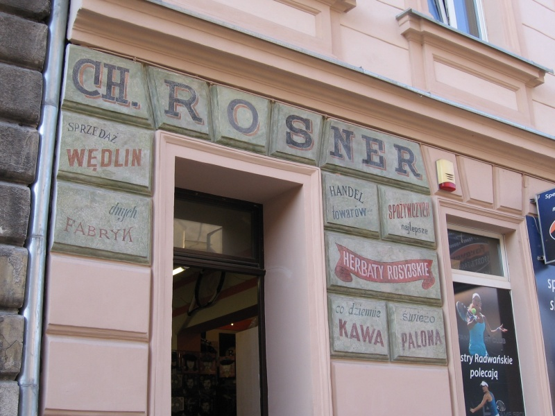 Renovated (reconstructed?) pre-war signs on the facade of a building in św. Wawrzyńca street