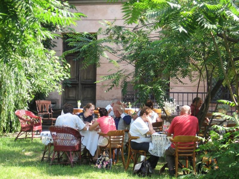 Cafe garden of Klezmer-Hois restaurant, Leopold Kozłowski as one of the restaurant's guests