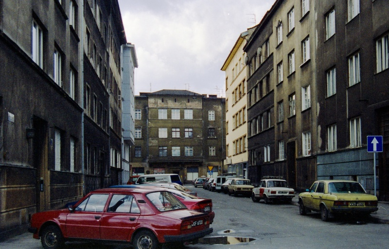street in prospect, parked cars, buildings in closed coverage