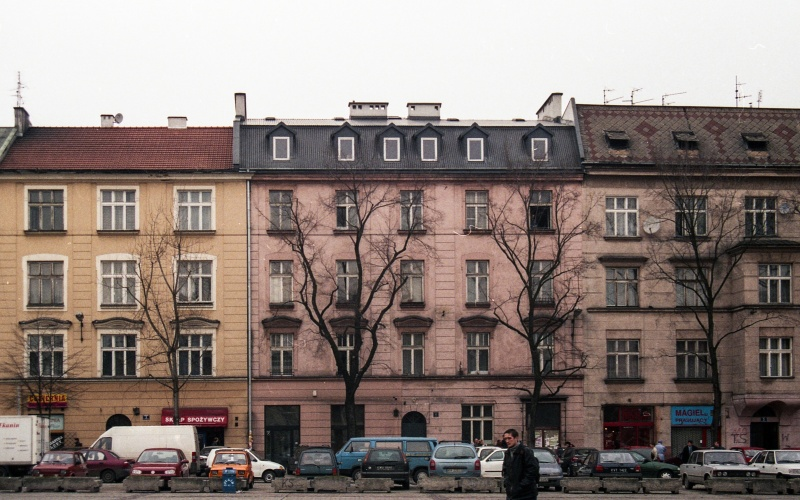 square, cars, front tenement facades