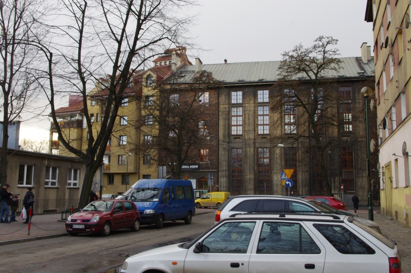 eastern street frontage; facades of buildings (right to left) nos. 17, 15, 13; on the left fragment of the building of Primary School no. 22; view towards the west from Chmielowskiego street;