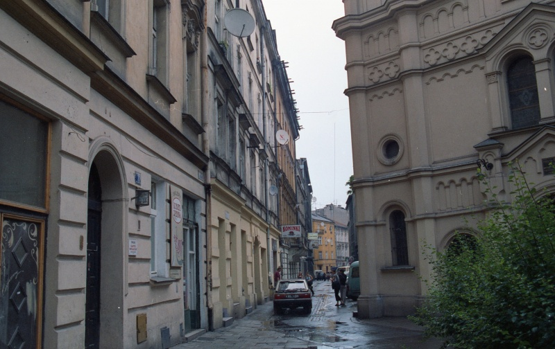 street in prospect, on the right bush and fragment of synagogue facade, on the left fragment of tenement elevations