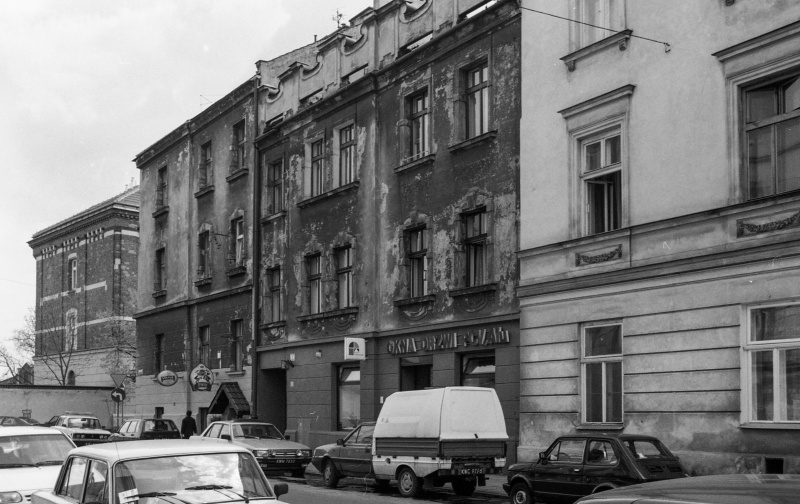 street, cars, densely-built tenements