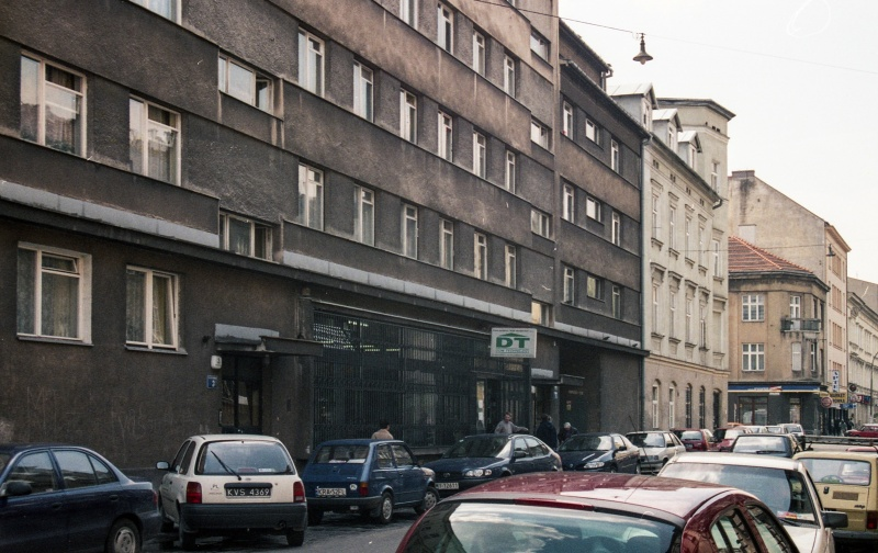 street, cars, densely-built tenements