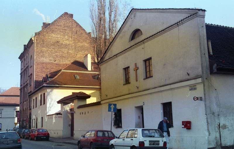 Skawińska street, cars, on the right house no. 6, in the back one-storey house no. 4, corner building no. 2