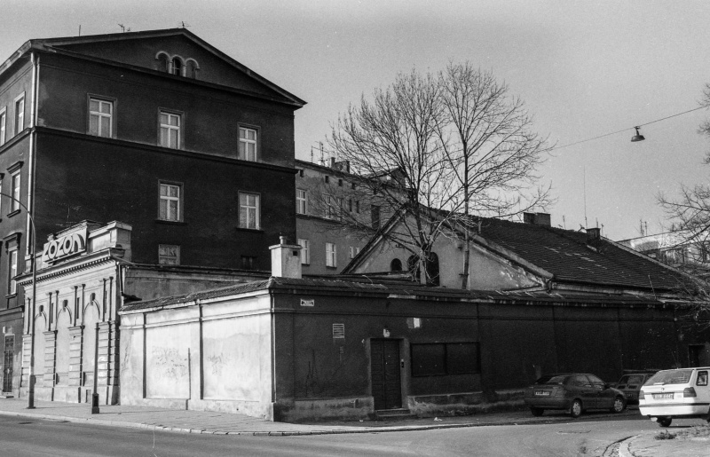 street junction, one-storey building fenced with a wall, on the left gable wall of a three-storey building, on the right exit of Gazowa street