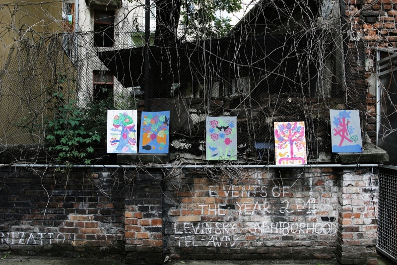 Artworks hanging on the fence in the courtyard of the building fo Pedagogical University