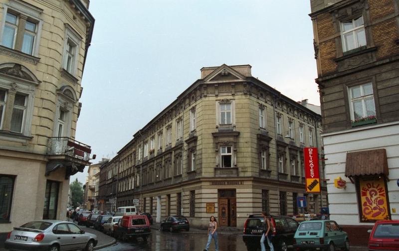 on the left exit of Miodowa street, in the background in prospect Bożego Ciała street, on the left and on the right corner tenement, in the centre two-storey tenement, frontage of Bożego Ciała street in prospect