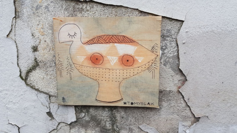 Street art creted with the use of tile art, authorship: Mateusz Tomyślak
