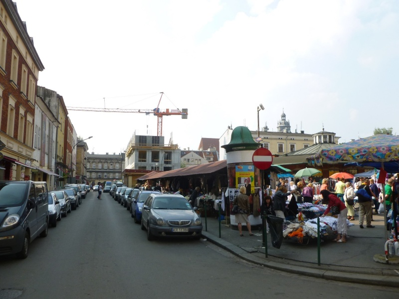 Market in Nowy square and the eastern frontage of Nowy square