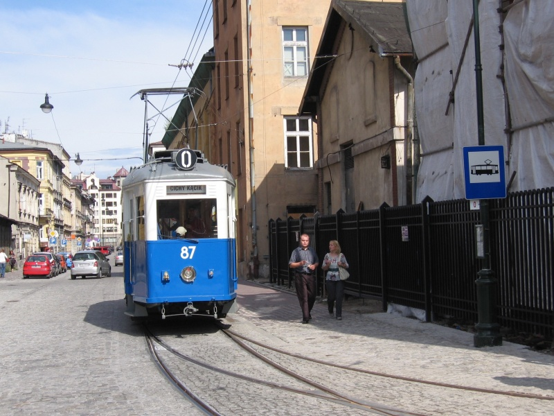 Tourist historic tram on św. Wawrzyńca street about to enter the historic tram depot, visible on the right hand side former stables for tram horses