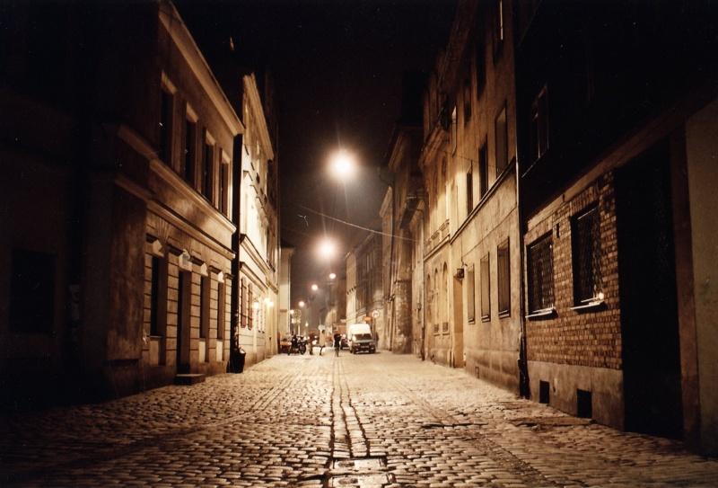 Józefa street by night, glittering cobble stones
