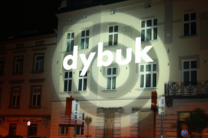 Tenement at 19 Miodowa street with projected writing saying Dybbuk