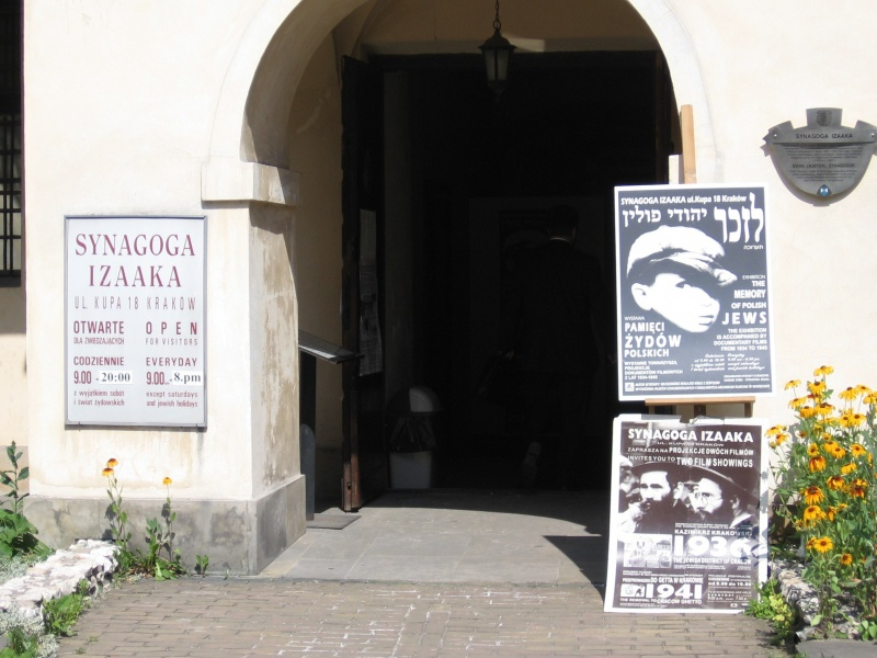 Entrance to Isaac synagogue with advertisements of tourist offers inside
