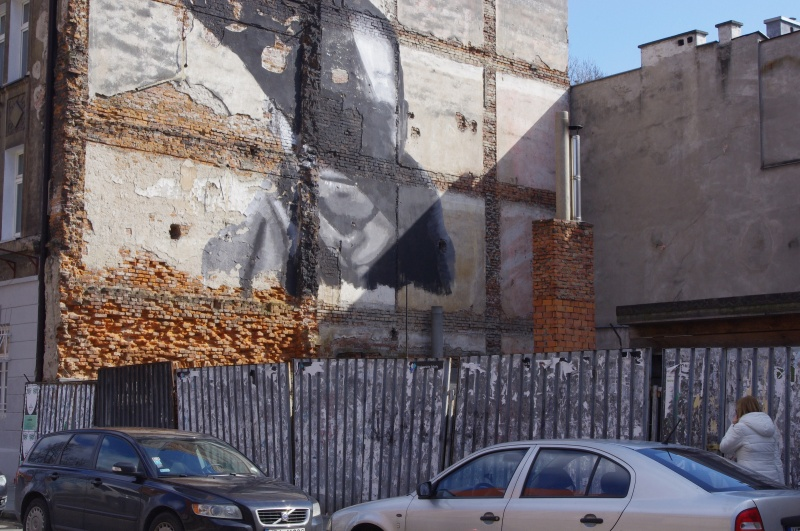 View of a site after demolition of a tenement in Wawrzyńca street, mural