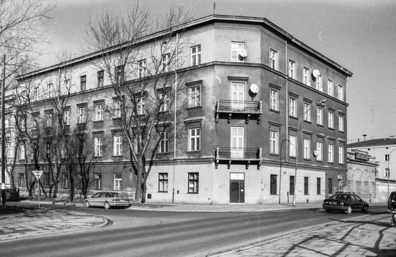Podgórska street, on the left exit of Mostowa street, car, in the centre three-storey corner building, on the right in the background car and one-storey house