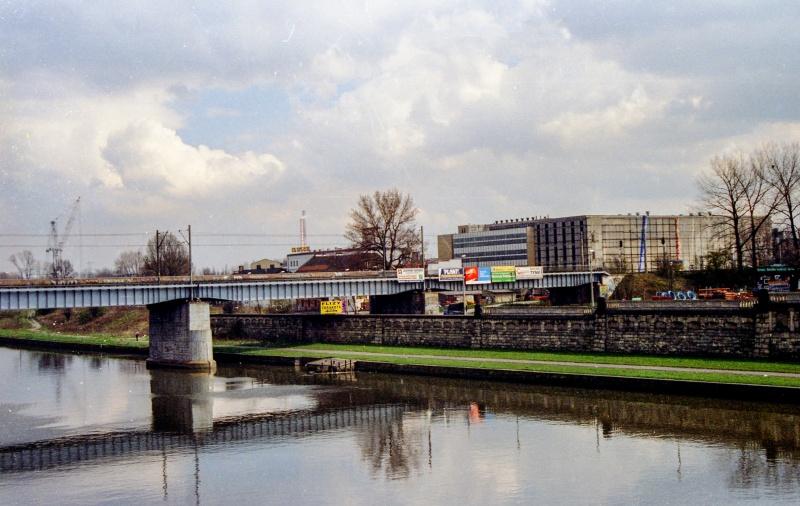 river, on the left bridge, in the background building in Starowiślna and Podgórska street