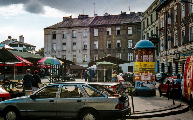 square, car, shopping stalls, on the right tenement facades