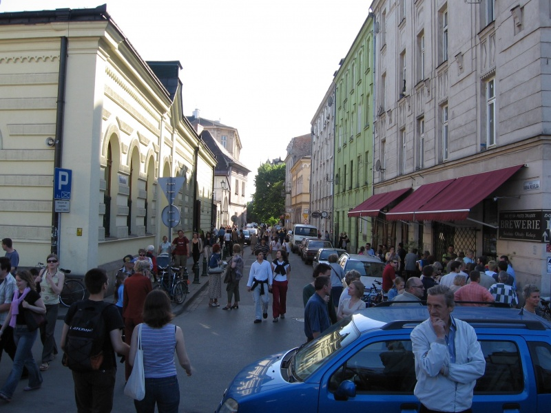 A view of Meiselsa street with the Centre for Jewish Culture in the former Jewish prayer house on the left and newly opened cafes on the right