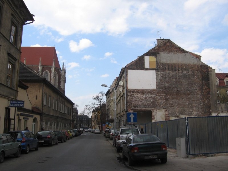 A view of Augustiańska street with a large empty plot after demolishments on the right hand side at the corner of Augustiańska and Węgłowa street