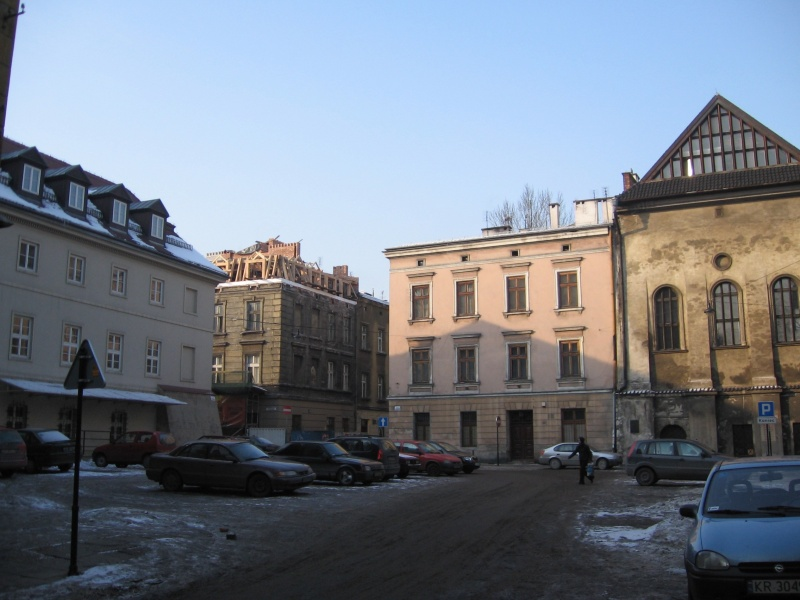 A view towards Józefa street from Wąska street - an extra floor added to a tenement house, the High synagogue