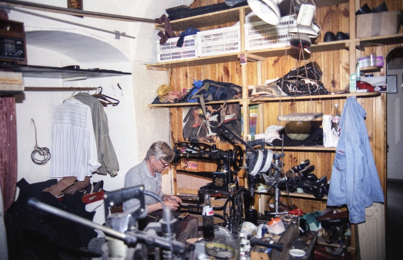 Workshop interior, man sitting by a sewing machine