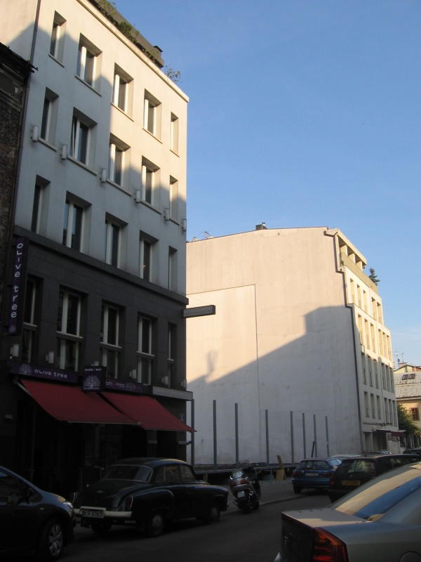 Eastern frontage of Kupa street (no. 6-12) with empty plots between new or renovated buildings