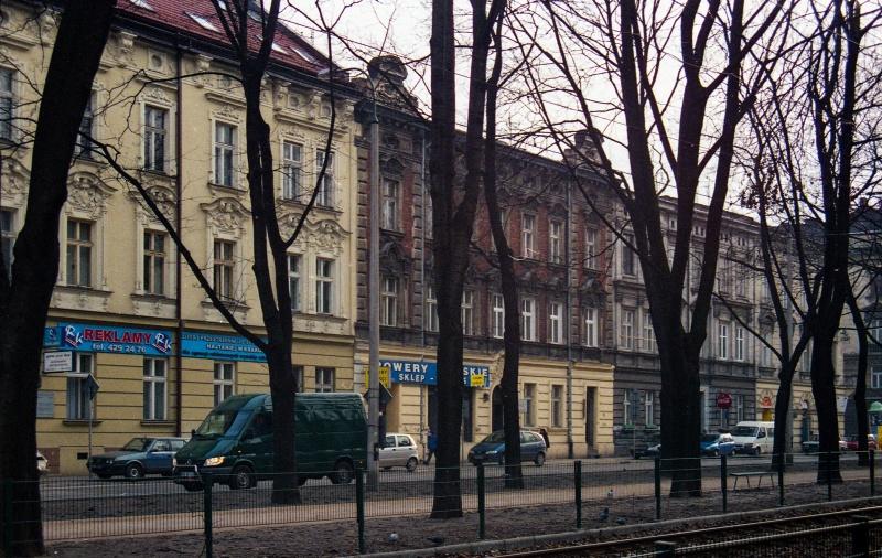 planty, trees, tramline, in the background tenements