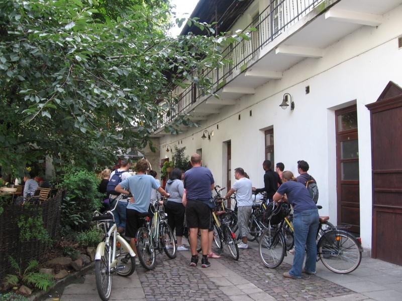 A tourist tour on bikes in the courtyard at no. 12 Józefa street