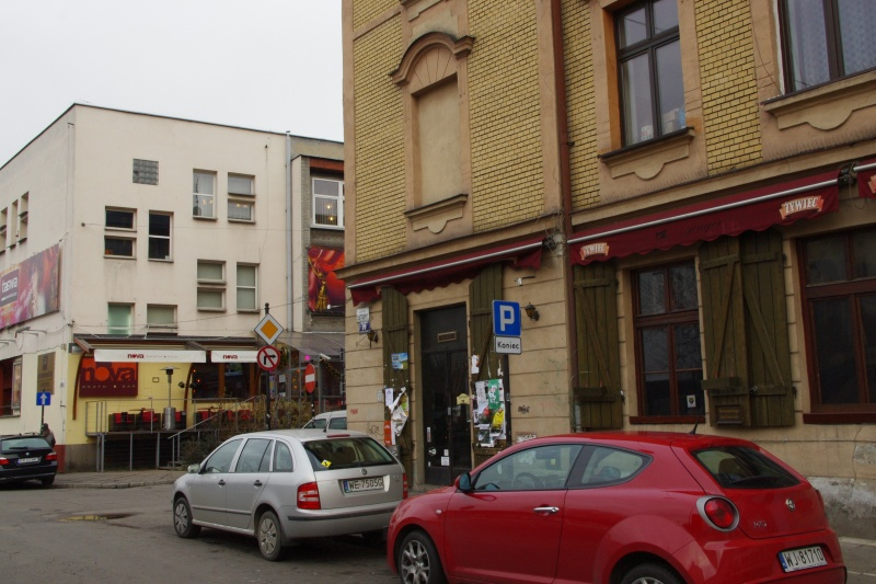 On the left Nova restaurant( Estery 18), on the right Singer cafe (Estery 20); fragment of eastern frontage of Estery street; view towards the north