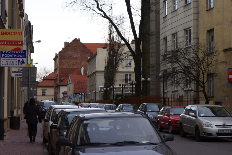Buildings in Skawińska street; on the left facade of building no. 13, on the right University Hospital 2nd Chair of Internal Medicine of the Collegium Medicum UJ (Skawińska no. 8) - former Israelite Hospital; view towards the east