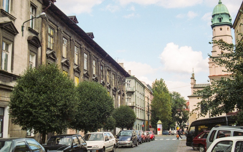 street in prospect, cars, elevations of tenements, on the right in the background town-hall