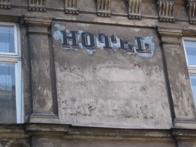 An old sign informing of a hotel on the wall of a tenement house at Brzozowa 1